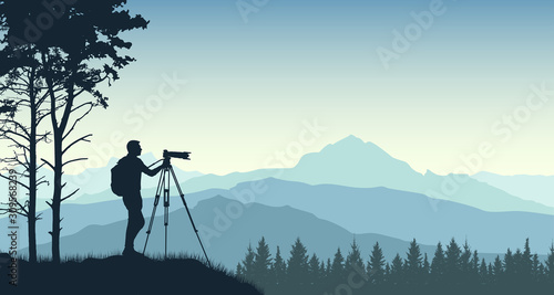 Obraz na plátně Photographer from a tripod photographs the landscape of nature