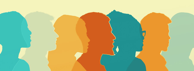 Diverse colored silhouettes of people looking in one direction