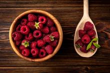 Fresh Raspberry On Dark Wooden...