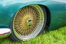 Gold Colored Spoke Rims At A Car
