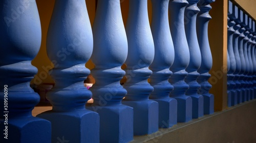 Sunlight and shadow on surface of blue stone balusters with yellow cement fence Canvas Print