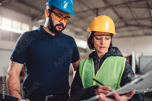 Fototapeta Workplace safety inspector writing a report at industrial factory obraz