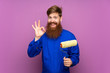 canvas print picture - Painter man with long beard over isolated purple background showing an ok sign with fingers