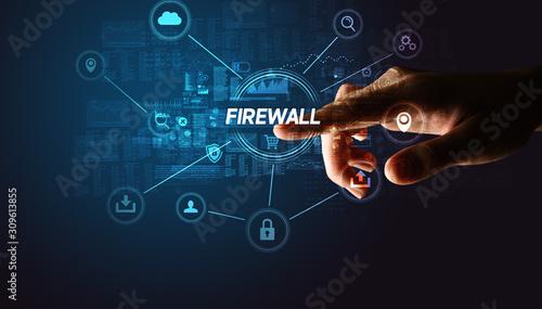 Cuadros en Lienzo Hand touching FIREWALL inscription, Cybersecurity concept