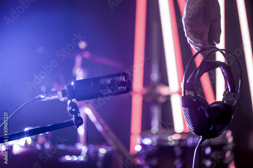 Studio microphone and headphones in the hand of a person close up, in a recording Studio or concert hall Canvas Print