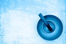 Two Singing Bowls Stand One On The Other On An Artistically Painted Background Of Light Blue. Vintage Singing Bowls Ready For Use For Healing Sound Massage. Top View.