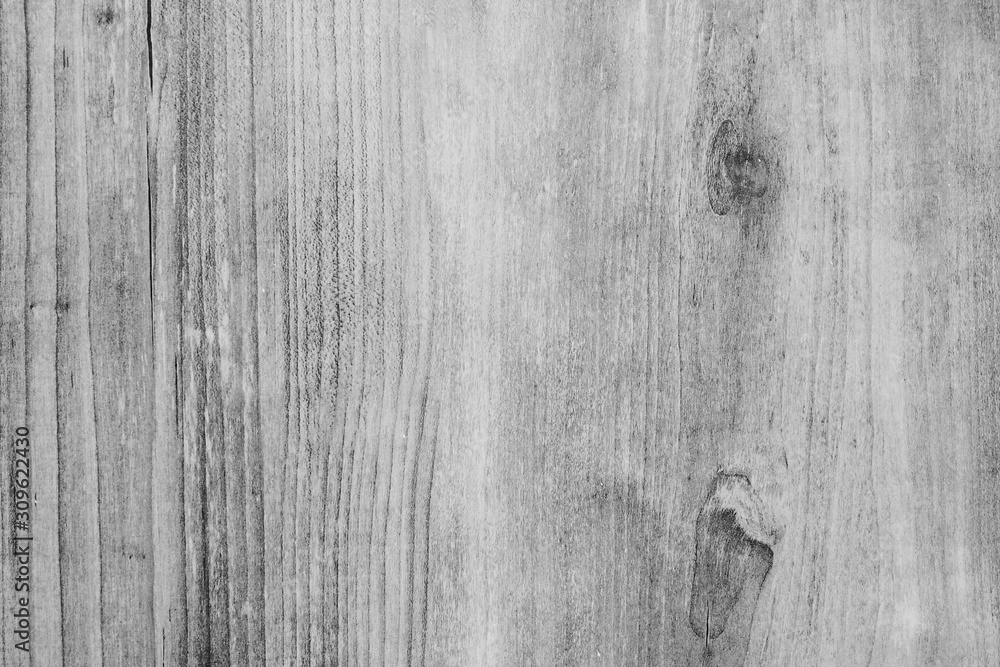 Fototapeta Closeup of wooden wall with rough surface and texture in black and white tone for grunge background and decoration. Cool banner on page and cover.