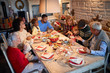 Friends and families sitting at a Christmas table