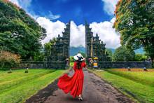 Woman Walking At Big Entrance Gate, Bali In Indonesia.