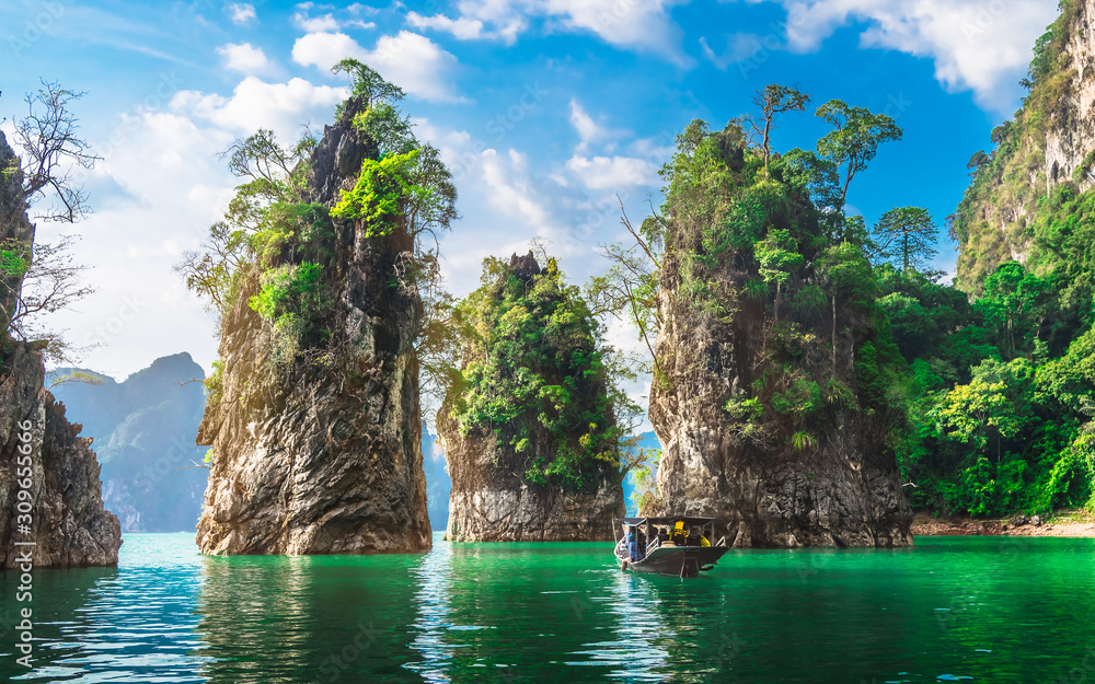 Fototapeta Beautiful nature scenic landscape view rock mountain Khao Sok national park with boat for travelers, Attractive famous popular place in Thailand, Destinations Scenery Asia, Water travel adventure trip