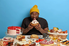 Happy Celebrating Sweet Tooth Man Bites Baked Pancakes With Cream, Eats All Desserts By Himself, Doesnt Prevent From Obesity, Makes Wrong Nutrition Choice, Greedily Devours Bakery Production