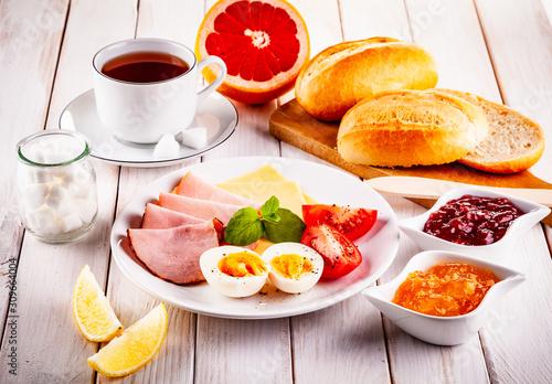 Fotografia, Obraz Continental breakfast on wooden table