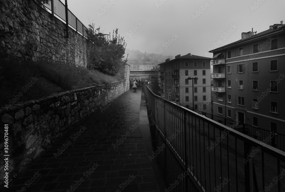 Fototapeta Gray morning in Perugia. Streets of Perugia at sunrise. Black and white Umbria. Italy.