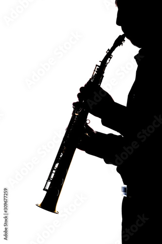 Photo saxafon on a white background in the hands of a musician silhouette
