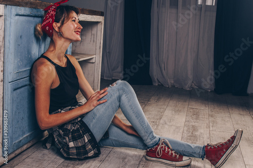 Portrait of a stunning smiling girl with red lips, dressed in a checkered red shirt and a bandana on her head Wallpaper Mural