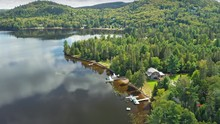 Aerial: Forest & Calm Tranquil Lac Raymond In Val Morin Laurentian Mountains Near Montreal, Quebec, Canada