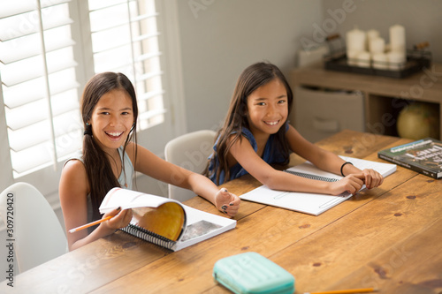 Young Girls Working On Their School Work