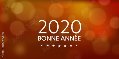Photo Bonne Année 2020 orangé avec des halos de lumières