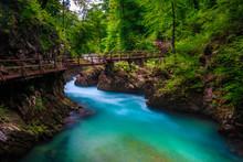 Turquoise Radovna River In Vintgar Gorge And Wooden Footbridge, Slovenia
