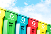 Row Of Colorful Recycle Bins A...