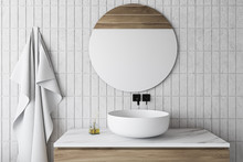 White Tile Bathroom With Sink And Round Mirror