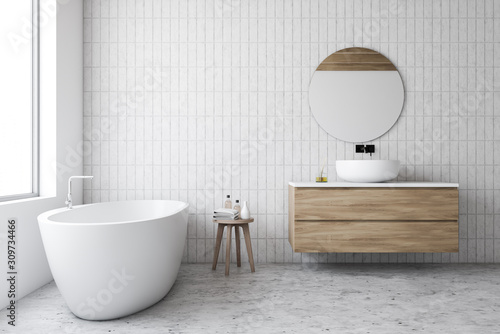 Luxury white tile bathroom, tub and round mirror - 309734466