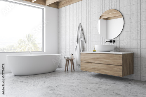 Loft white tile bathroom corner, tub and sink - 309734474