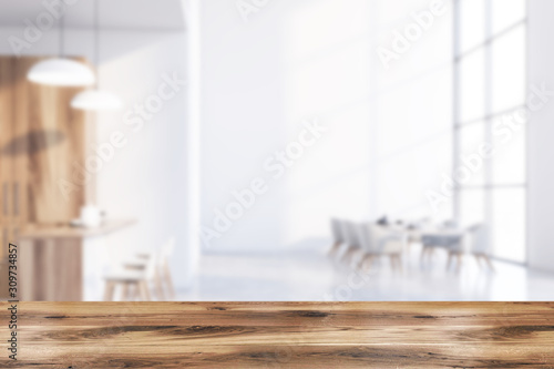Table in blurry white dining room Tablou Canvas
