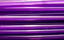Plastic Wire Macro. Purple Plastic Tube Closeup. Plastic In Coil For 3D Printing.