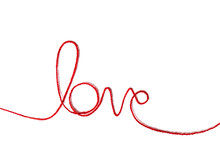 Red Yarn In The Shape Of A Word - Love On White Background.Red Thread. Valentine's Day