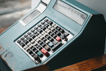 Old Cash Register On A Dark Wo...