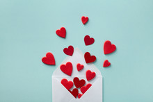 Valentine Day Greeting Concept. Envelope And Red Hearts On Blue Background Top View. Flat Lay.