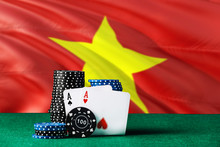 Vietnam Casino Theme. Two Ace In Poker Game, Cards And Black Chips On Green Table With National Flag Background. Gambling And Betting.