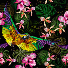 Panel Szklany Egzotyczne Tropical parrots, orchids flowers and palm leaves seamless pattern. Jungle paradise background. Macaws. Fashionable template for design of clothes, textiles