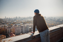 Guy Looking At The City View F...