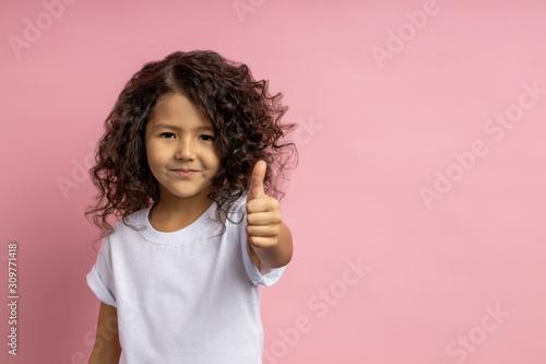 Fototapeta Portrait of a pretty curly little girl obraz