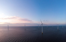Aerial View Of Wind Turbines A...
