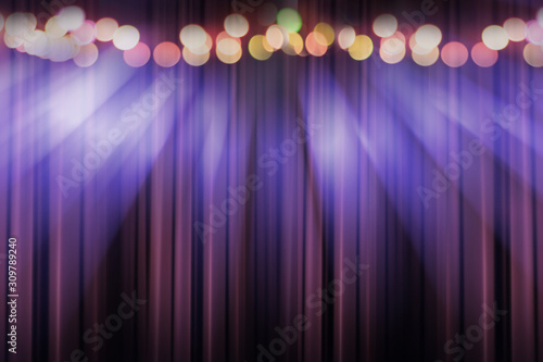 Obraz blurred theater stage with purple curtains and spotlights, abstract image of concert lighting - fototapety do salonu