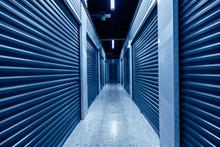 Hallway With Blue Storage Units. Phantom Blue Colors