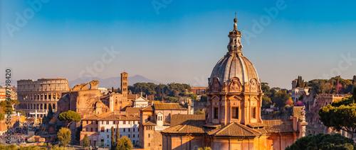 Fotografia Panorama Rome Italy, sunset city Colosseum ruins Roman Forum from square of Veni