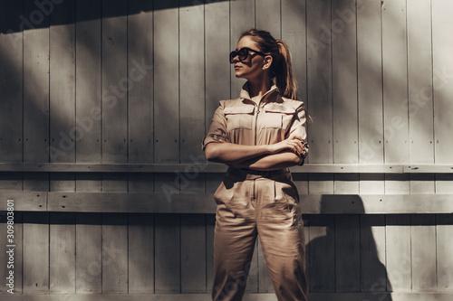 Cuadros en Lienzo Portrait of Stylish Girl Wears Women Overalls and Black Sunglasses