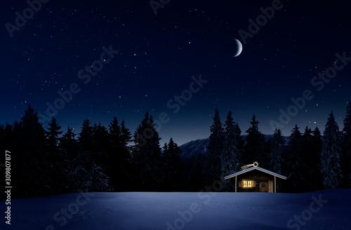 fototapeta na drzwi i meble Weihnachtlich beleuchtete Hütte in Kalter Winternacht mit Sternenhimmel