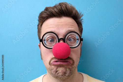 Unhappy man with a red nose and funny glasses celebrating all fools day Canvas Print