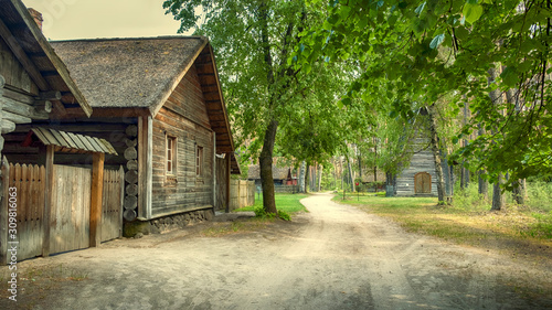 Riga,  Latvia, panorama old wooden village with residential buildings, a chapel in the forest of the Ethnographic Museum in the open air