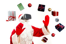 Christmas. Santa Claus In Black Virtual Reality Glasses Makes Gestures With His Hands. Surprise, Emotion. New Technology. Isolated On White Background.