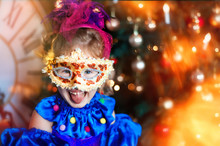 Portrait Of Funny Laughing 4 Years Old Girl In Carnival Venetian Mask. Christmas Tree, Big Clock On Background. Christmas Lights. Space For Text. Happy And Funny Christmas And New Year In Childhood
