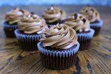 Cupcakes With Frosting And Spr...
