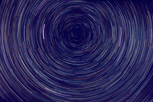 Star Trails -  Light Streaks Of Stars Around Polaris In The Night Sky Due To Earth's Rotation