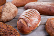 Fresh crusty bread on wooden background. Delicious freshly baked bread.