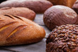 Whole grain artisan bread. Bread with pumpkin seeds close up. Healthy homemade product.